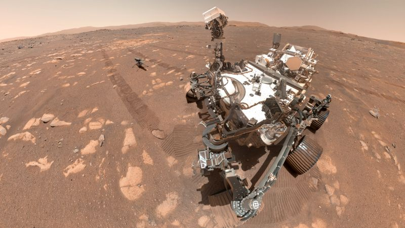 """A """"selfie"""" taken by NASA's Perseverance rover, including the Mars Helicopter Ingenuity resting between the rover's tracks where it was placed on the ground in preparation for test flights.  NASA/JPL-Caltech"""