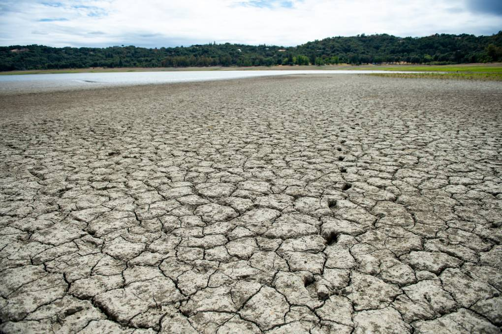 Footprints are visible in the dry earth on what once was the lake floor at Lake Mendocino on June 11, 2021. Courtesy of Beth LeBerge