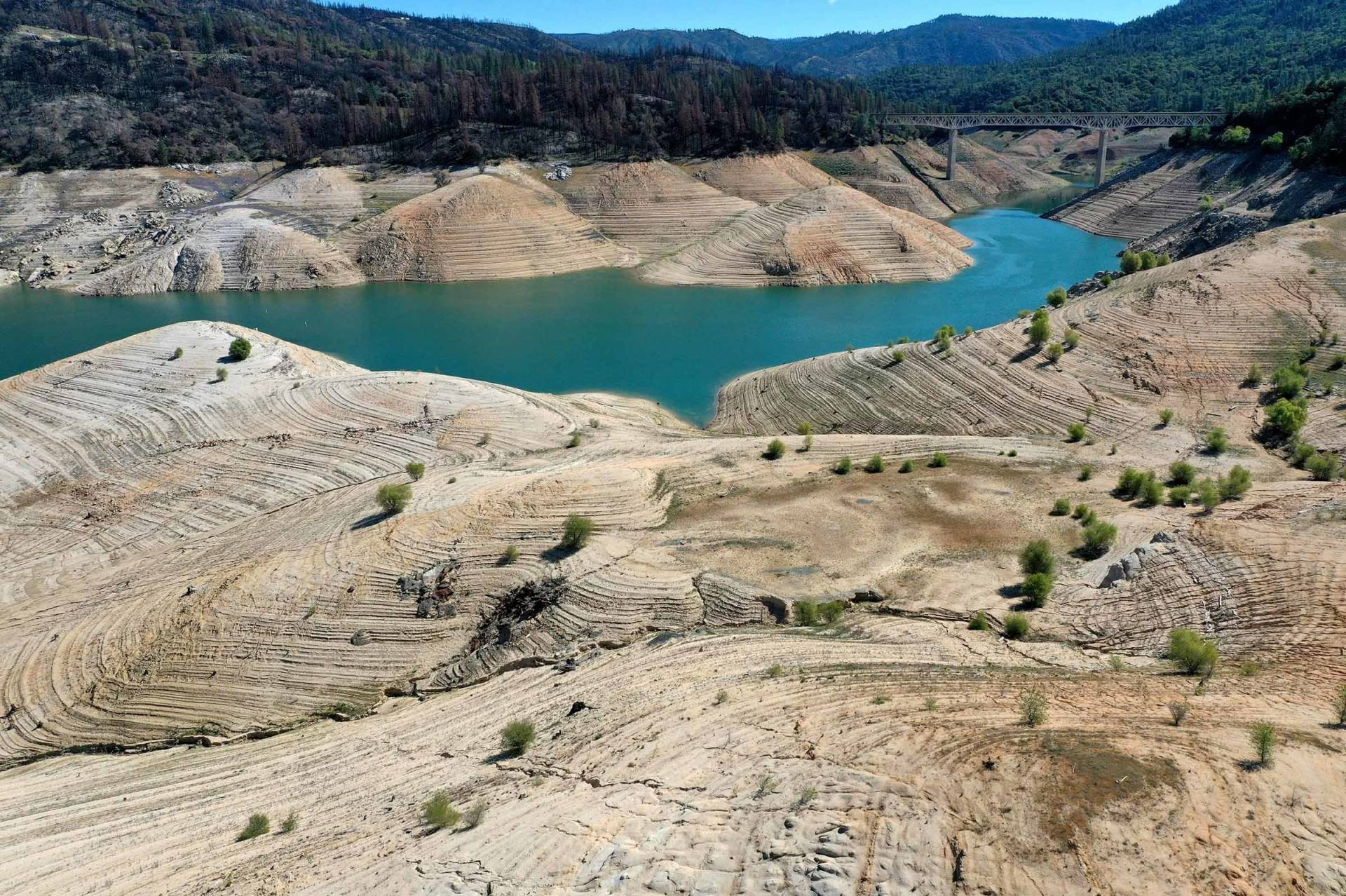 In an aerial view, low water levels are visible at Lake Oroville on April 27, 2021 in Oroville, California.
