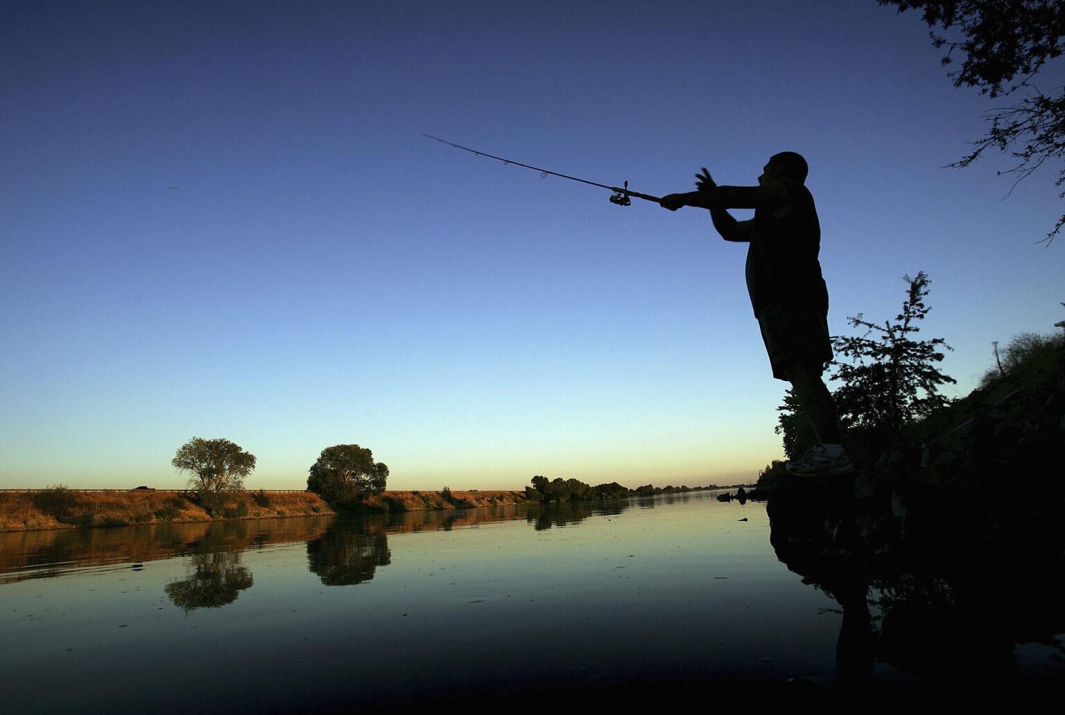 A fisherman casts his line into the Sacramento River in the Sacramento-San Joaquin River Delta on September 29, 2005 south of Sacramento, California.