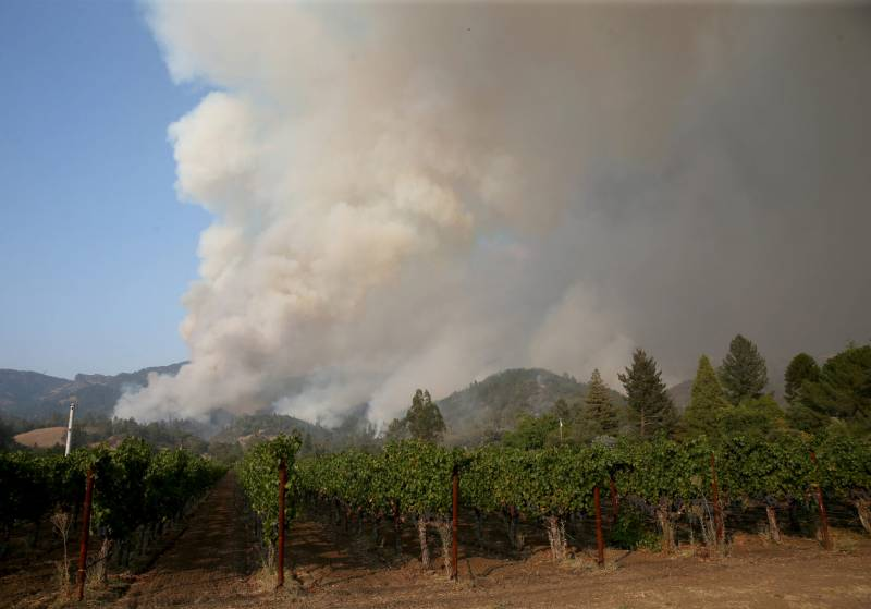 Smoke from the Glass Fire rises above the Jericho Canyon Vineyard and Winery about a mile out of downtown Calistoga, California.