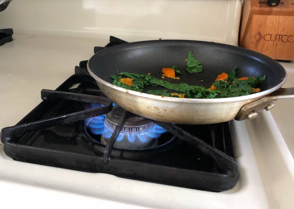 frying pan over gas burner