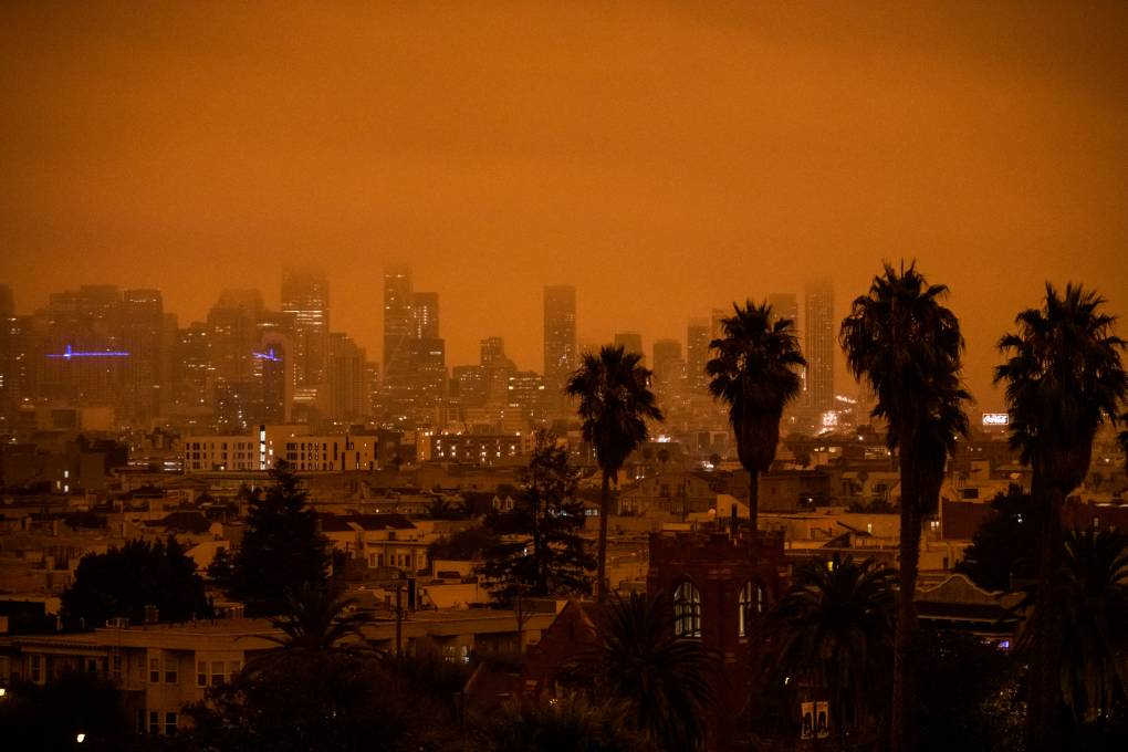 A view of the San Francisco skyline from Dolores Park in San Francisco on Sept. 9, 2020. Smoke in the atmosphere gave the sky an orange tint. Beth LaBerge/KQED