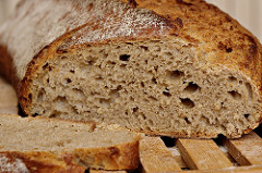Bread made with wheat contains gluten.