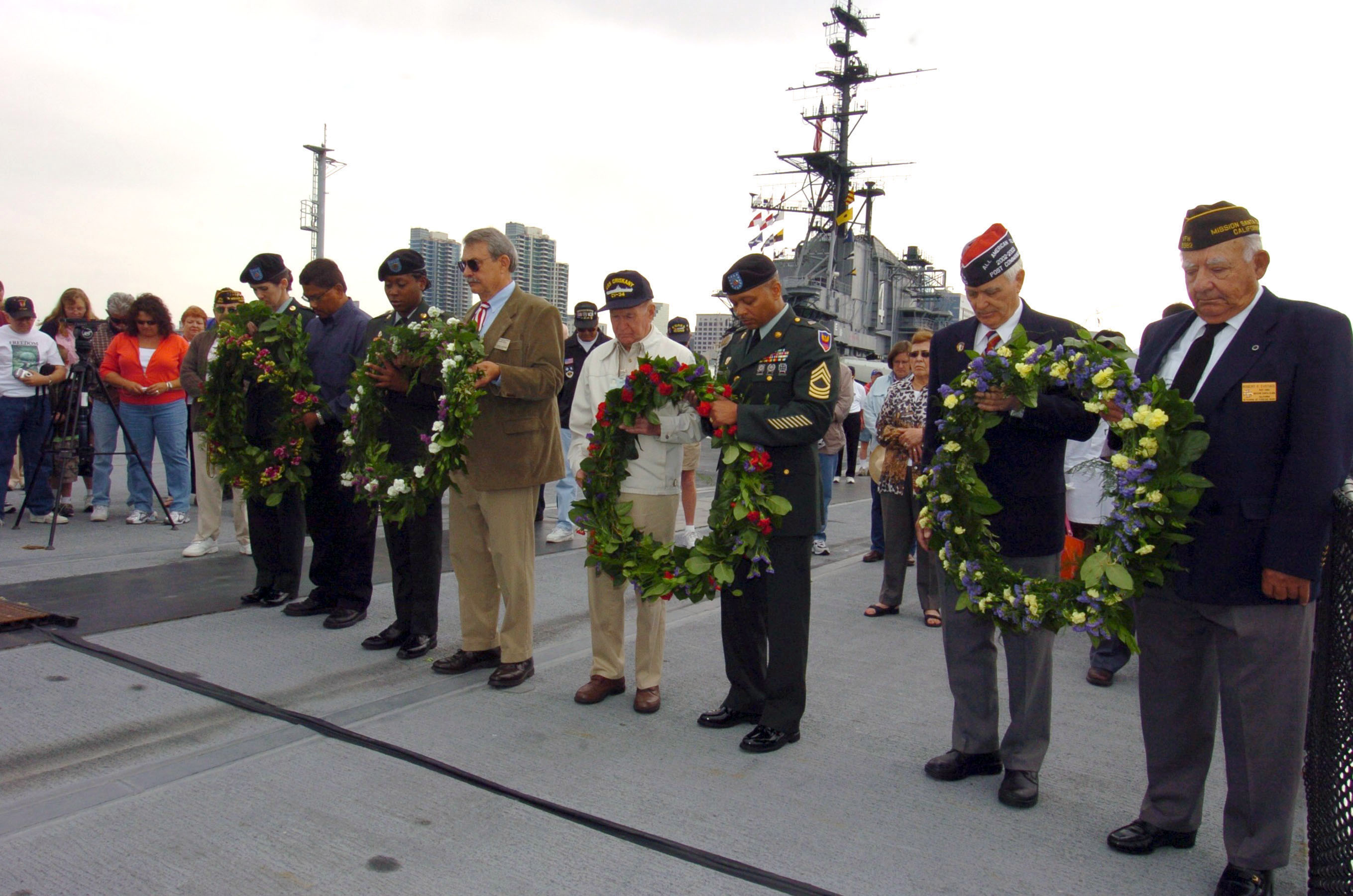Military veterans observing a moment of silience.