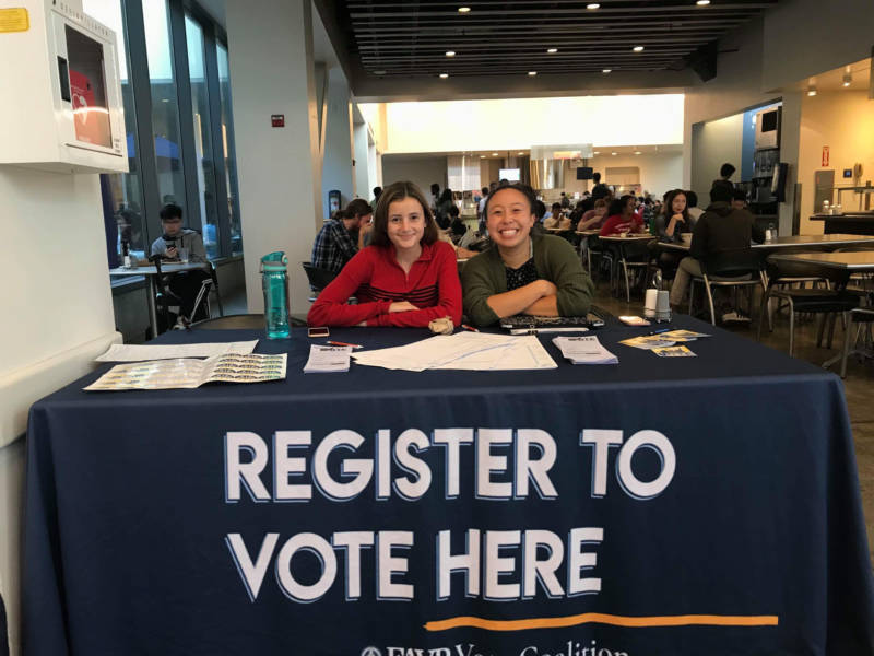 two UC Berkeley students registering people to vote for the upcoming midterm election