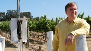 David Graves, co-owner of Saintsbury Winery, in the Carneros region of the Napa Valley, an area known for the quality of its Pinot Noir wines. Graves stands next to a weather station that monitors conditions in his vineyards. (Photo by Joan Johnson Miller/KQED, 2007).