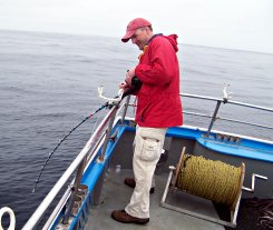 Producer Chris Bauer fishes for squid and tries to stay on his feet.