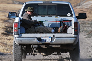 QUEST Producer Chris Bauer rides into the hunt in the back of a pick-up truck.