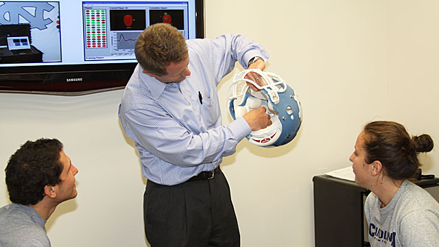 Dr. Kevin Guskiewicz and his team use helmet accelerometers, known as the Head Impact Telemetry (HIT) systems, to identify at-risk behavior on the football field.