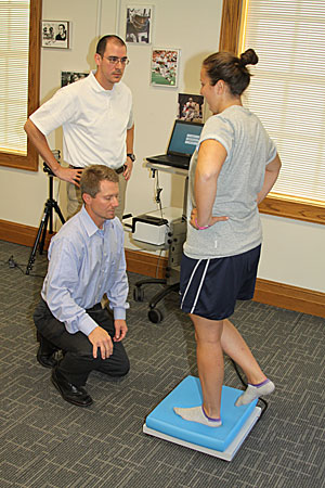 Kevin Guskiewicz utilizes balance and orientation tests to determine the severity of sports-related head injuries.