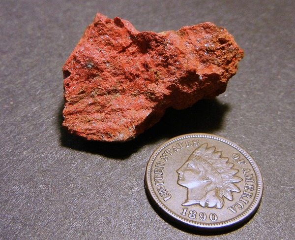 New Almaden cinnabar is notable for its tiny crystals that give the ore a glittering appearance.