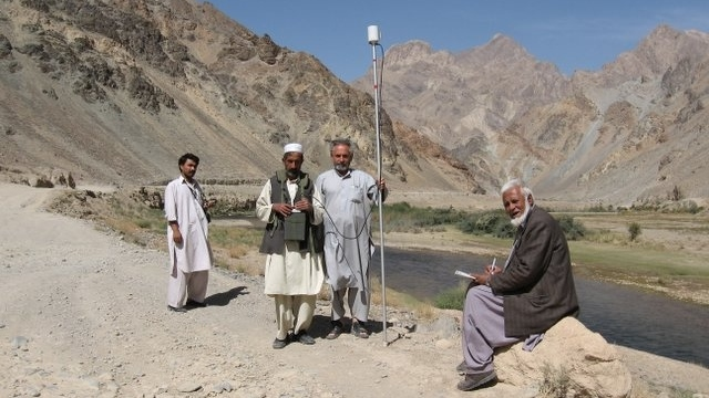 Geophysicists of the Afghanistan Geological Survey operate a portable proton-precession magnetometer in the countryside. Good science can be done on a shoestring. US Geological Survey photo