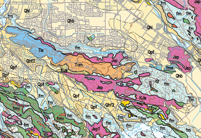 """Units Tls and Tmc (Tertiary rocks of Loma Chiquita Ridge and Mount Chuar) belong to the Sierra Azul block; the surrounding serpentinite (Jsp) and melange (fm) and basaltic lava (fpv) are much older and belong to the New Almaden block (lower left). Units marked """"Q"""" are sediments."""