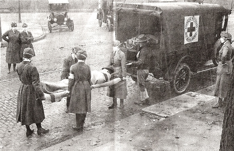 1918 flu victim and members of the American Red Cross