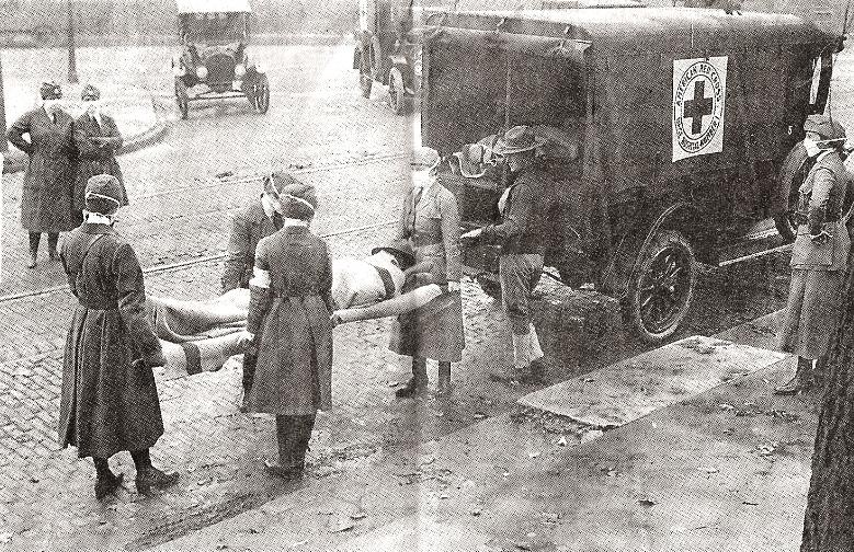 1918 flu victim and members of the American Red Cross