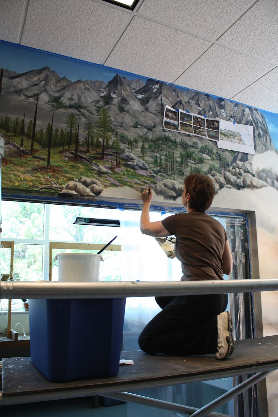Bakker working on the wildlife mural at West Valley College - photo by Molly Schrey