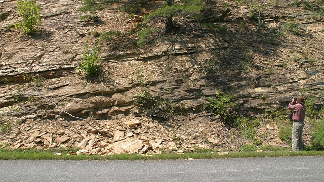 U.S. Geological Survey researcher Ed Harp records a small rockfall triggered by the 2011 Virginia earthquake. USGS photo by Randall Jibson