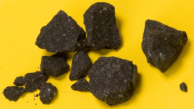 Specimen number SM2 of the Sutter's Mill meteorite fall was run over by a car before NASA scientist Peter Jenniskens found it on April 24, 2012. The largest grain is a centimeter across. Image: P. Jenniskens (SETI Institute) and Eric James (NASA Ames)