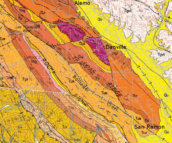 Rocks of Las Trampas: Tn, Neroly Formation (Miocene); Tbr/Tbg/Tbd, Briones Formation (Miocene); Tus, unnamed sedimentary/volcanic rocks (Pliocene). Alameda and Contra Costa county geologic maps are spliced together at the thin white line