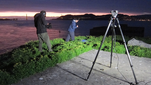 Multimedia Producer Joshua Cassidy films Alex Nguyen looking for milipedes on Alcatraz.