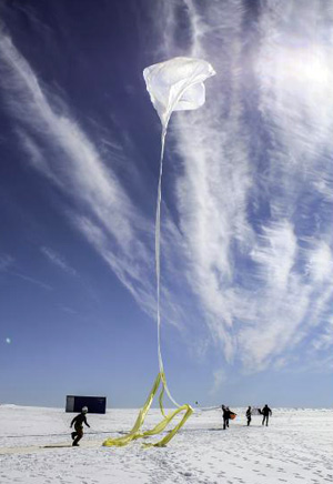 The BARREL team launches one of 20 research balloons over Antarctica. (Photo: NASA/S. Spain)
