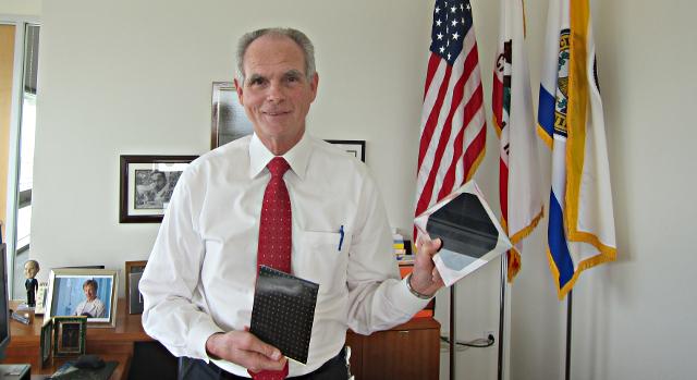 "Chuck Reed, named 'Green Mayor"" by former California Governor Arnold Schwarzenegger,  shows off solar cells designed by local companies."