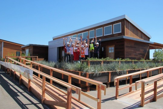 The Stanford Solar Decathlon team celebrates after reassembling its house in Irvine just two days before the competition. Photo courtesy Stanford Solar Decathlon