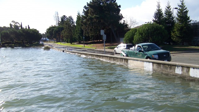 Last December the King Tide brought high water very close to the top of a containment wall in Alameda.  Photo courtesy of East Bay Regional Park District.