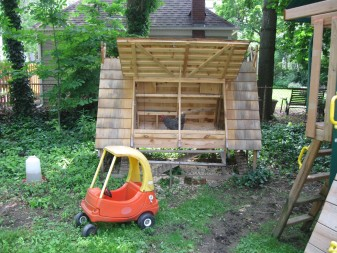 Wilson's chicken coop shares backyard space with his kids' swing-set and other toys.
