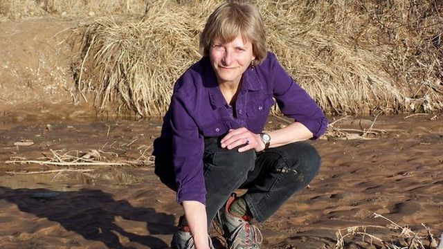 Freshwater expert Sandra Postel in a river bed
