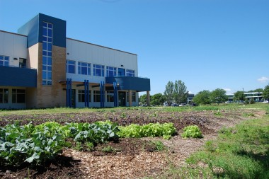Badger Rock Middle School, with its vegetable garden in the foreground.