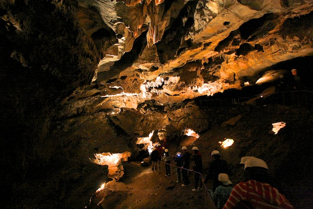 A tour group explores California Cavern.