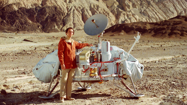 Carl Sagan Poses with Model of Viking Lander