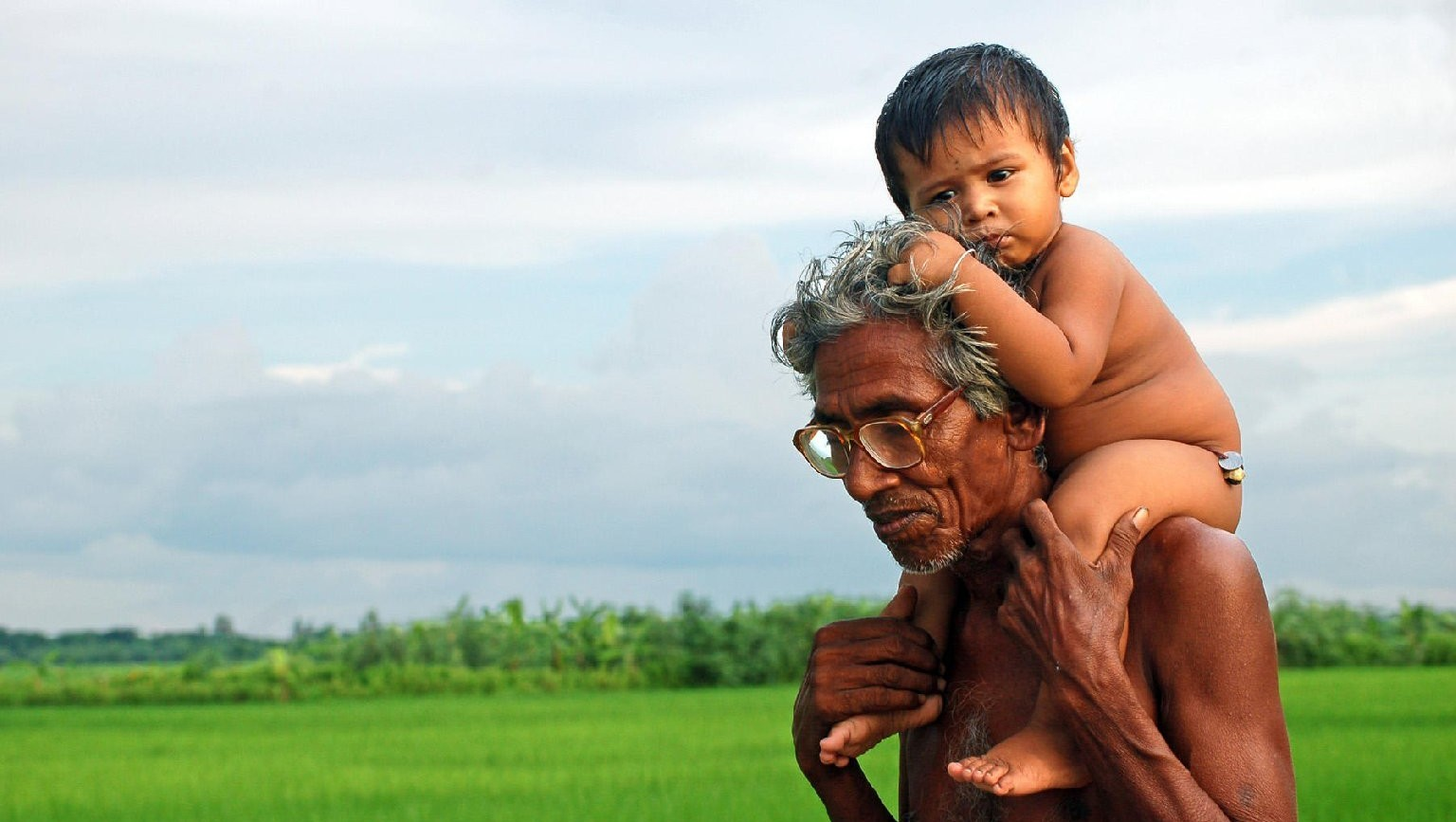 A grandfather in India enjoys the company of his grandson.