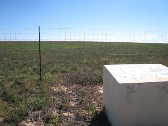 Basin F, one of the most contaminated sites, now looks just like another spot on the prairie. (Photo by Ariana Brocious, NET News)