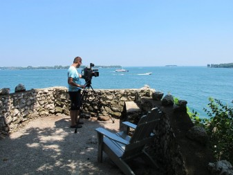Videographer Milan Jovanovic takes in the expanse of lake and islands visible from Perry's Lookout. Credit: Jean O'Malley