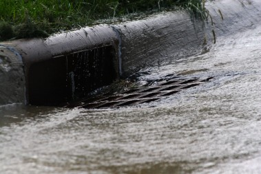 Heavy rains can overload the sewers in some cities and cause raw sewage to enter waterways.  Photo credit: wikimedia