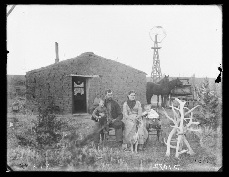 "Solomon Butcher photographed many pioneer families in Custer County prior to 1901.  I like to look at the objects this family chose to present for the photographer. Were they sending a message to their relatives back East?  Did the presence of elk antlers (no longer found in Custer County) tell their family and friends ""we've got enough to eat""?  (Caption by Larkin Powell. Photo by Solomon Butcher; Library of Congress Collection.)"
