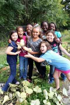 Students from Prospect Elementary pick squash as part of their ecologically-minded curriculum. Credit: Hannah Ball-Damberg.