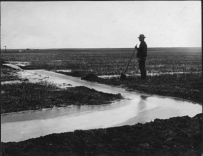 """A new irrigation ditch, 1909.  The """"North Platte Project"""" brought water to a landscape that had previously not supported crops.  You can almost hear the water soaking into the soil in this photo, and you can see how much effort this farmer put into this landscape modification.  (Caption by Larkin Powell. Photo: National Archives Collection.)"""