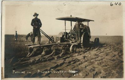 In this undated photo, a Brown County farmer uses mechanization to turn the prairie to plant crops.  Many of Nebraska's landscapes had been marginal for cropland.  But as mechanization and the potential for irrigation merged, many of our landscapes in Nebraska went under the plow.  (Caption by Larkin Powell. Photo: Sellor Museum Collection; Brown County Historical Society.)