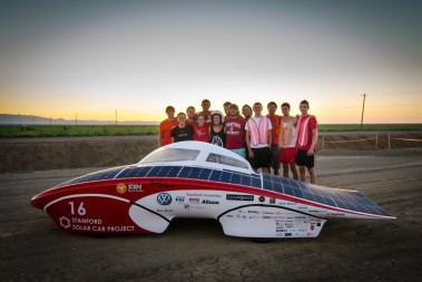 Stanford students stand behind their design Luminos which can reach speeds of 70 mph. Photo: Mark Shwartz