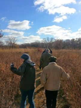 Visitors to the Aldo Leopold Nature Center learn about Prairie Grasses.  Photo courtesy of Margaret Broeren
