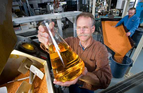 Rick Barrows, a fish physiologist with the USDA, has tested more than 120 ingredients for fish pellets including flax seed oil seen here. Photo courtesy USDA.