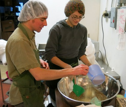 Plant Kingdom owner Jeremy Koosed and employee Laura B mix ingredients for hemp-based baked goods. Credit: Anne Glausser, ideastream