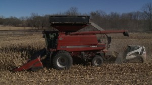 The FarmMax Farm Waste Recovery Device attaches onto existing corn harvesting combines.