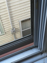 Window gaps, like this one, can be a major source of air and water leakage.