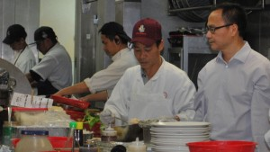 Willy Ng, right, in the kitchen of his Daly City restaurant Koi Palace.