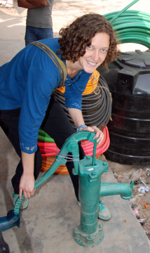 Amy Pickering with a handpump